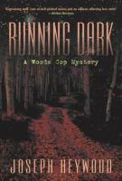 Running dark : a woods cop mystery